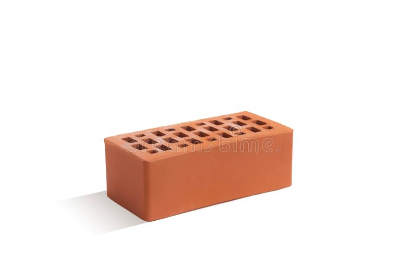 Red brick brick block on a white background. Ceramic block of a new development in the construction sector stock photography
