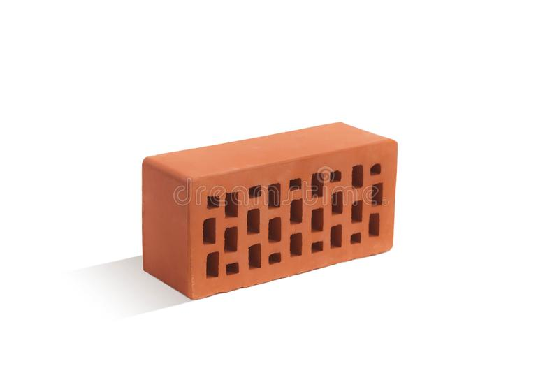 Red brick brick block on a white background. Ceramic block of a new development in the construction sector stock photo