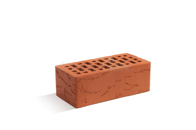 Red brick brick block on a white background. Ceramic block of a new development in the construction sector stock photos