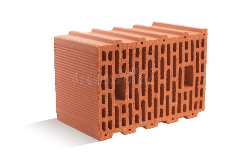 Red brick brick block on a white background. Ceramic block of a new development in the construction sector royalty free stock photo