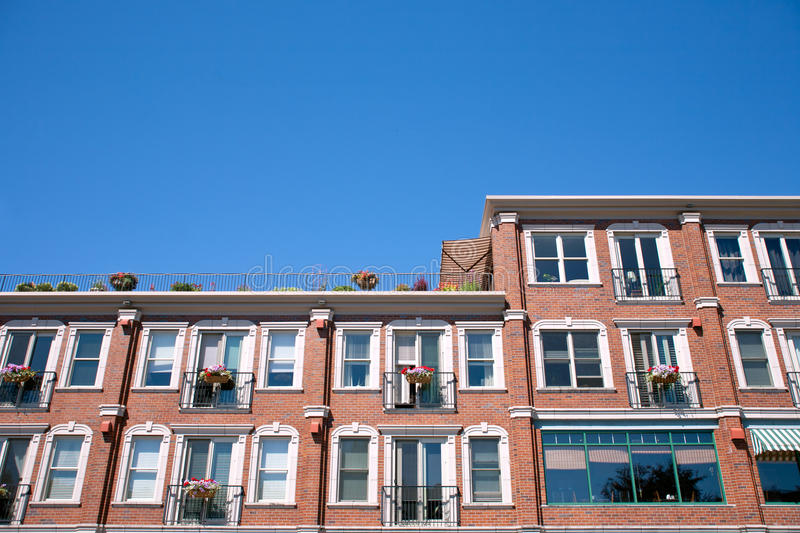 Red brick building facade. With windows stock image