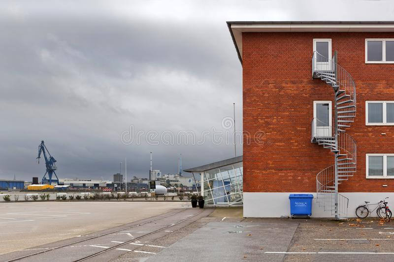 Red brick building with a spiral staircase in the port of Aarhus royalty free stock photos
