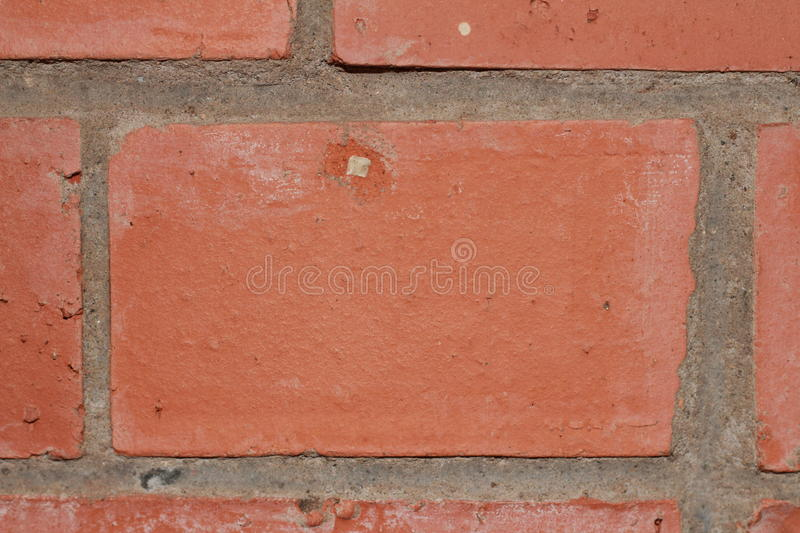 Red brick and cement texture as part of a wall frame close-up stock images