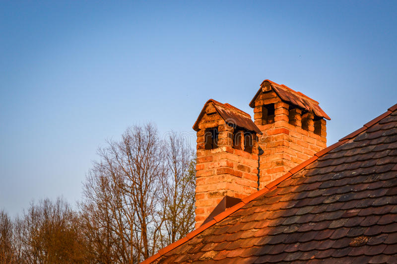 Red brick chimneys royalty free stock photo