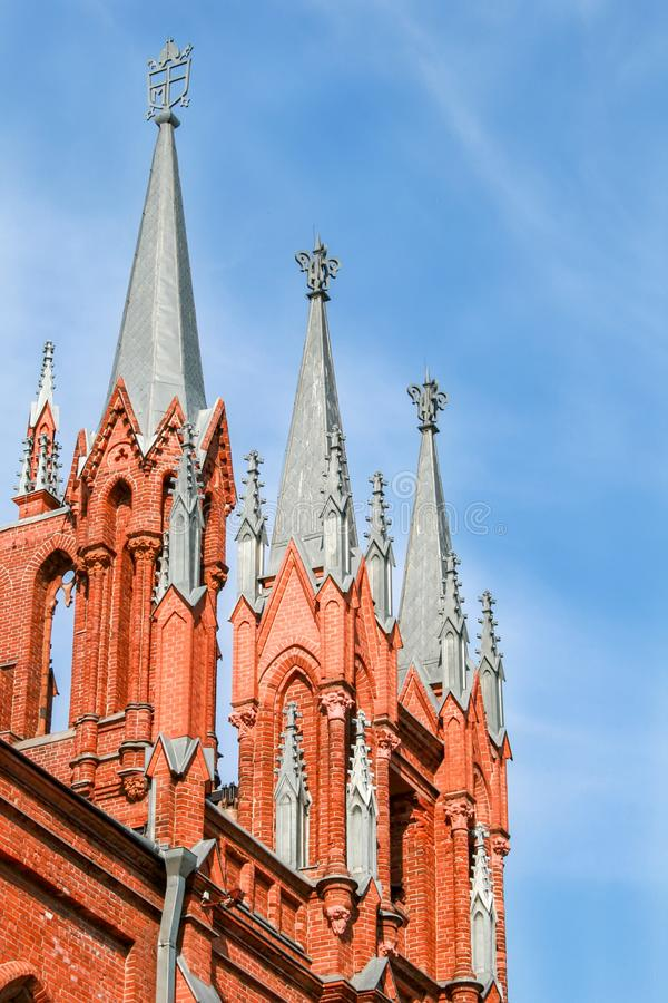 Red brick church against a blue sky royalty free stock photography