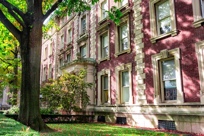 Red brick Columbia university campus building in shades of colorful trees stock images