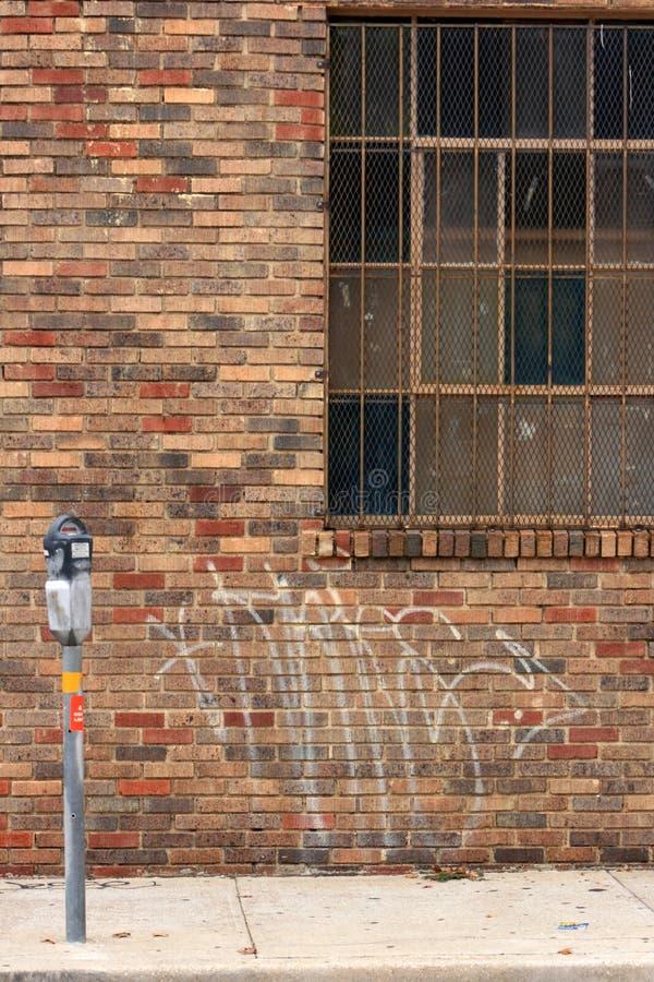 Red brick facade barred window meter royalty free stock photos