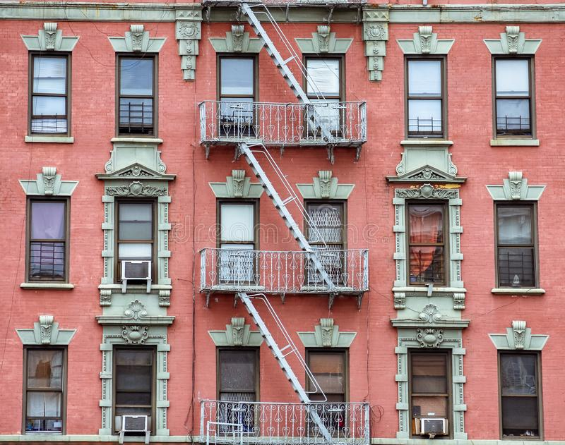 Red brick facade, and fire stairs. Harlem, NYC.  royalty free stock image