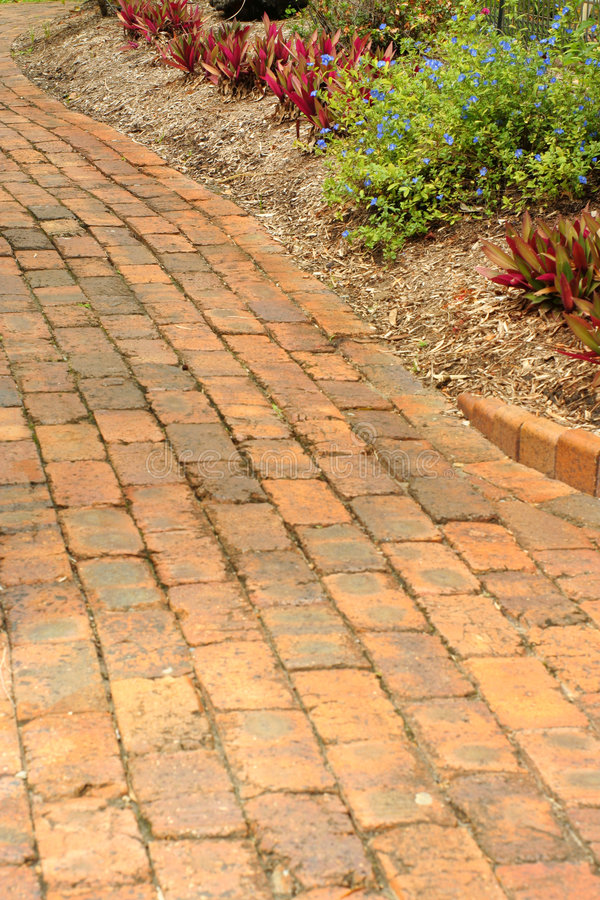 Red brick garden path stock images