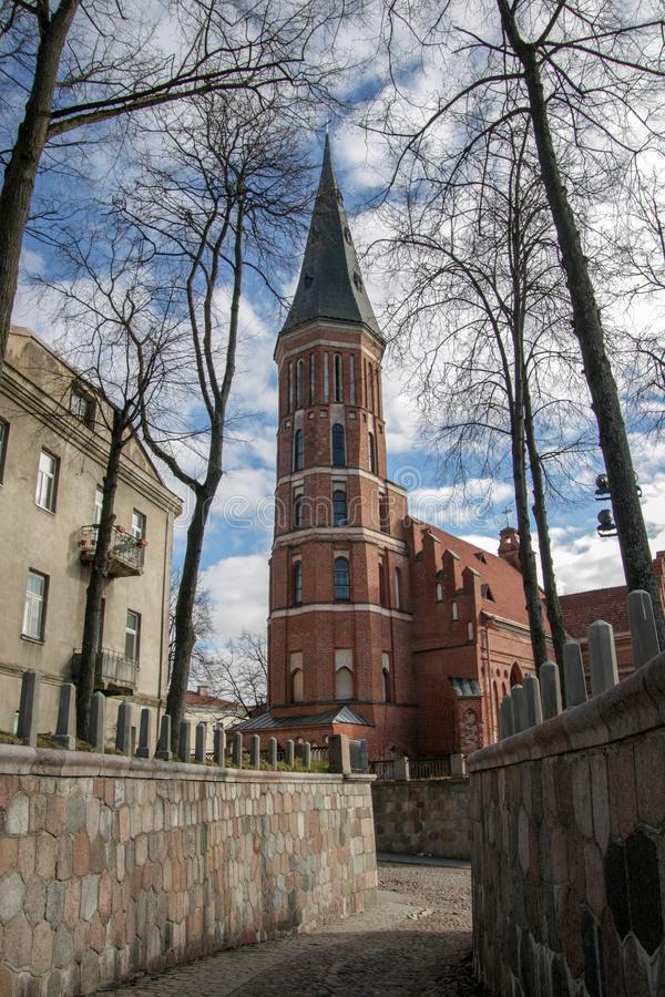 Red brick gothic church with bell tower royalty free stock image