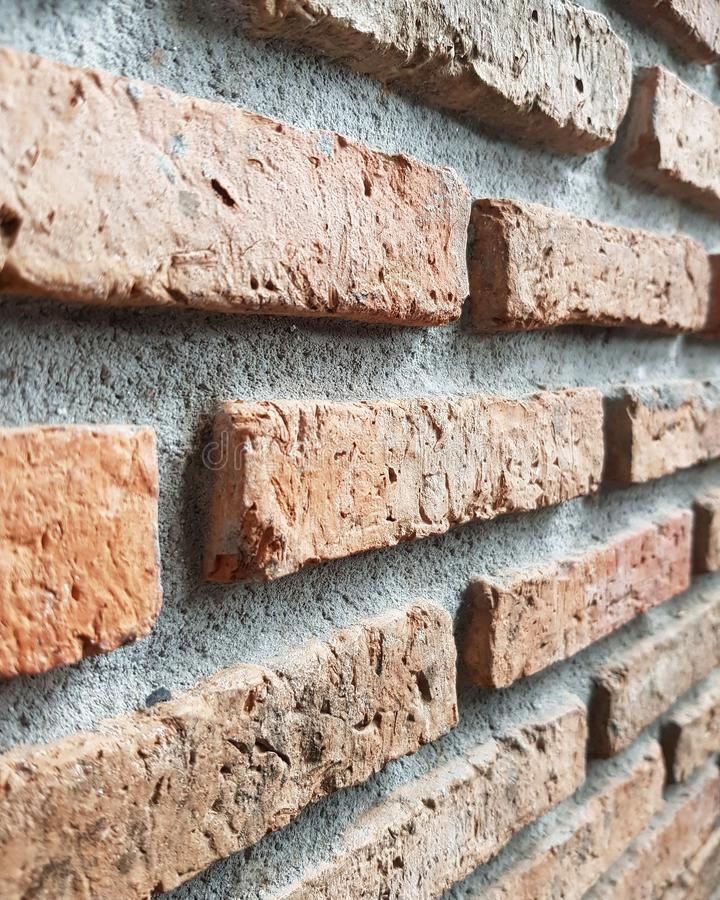 Red brick wall background textured. Wallpaper, desktop, backdrop, design, pattern, art, line, zigzag, detail, close-up, interior, exterior, decor, decoration royalty free stock image