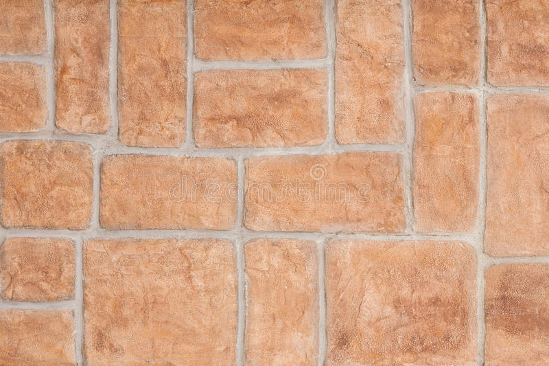 Red brick wall background. Wall decorative false bricks texture. royalty free stock photo
