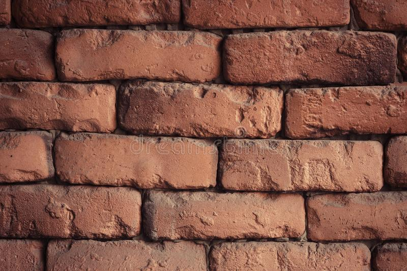 Red brick wall closeup. Old red brick wall texture background royalty free stock image
