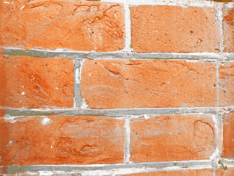 Red brick wall with concrete. In three rows of bricks stock photo