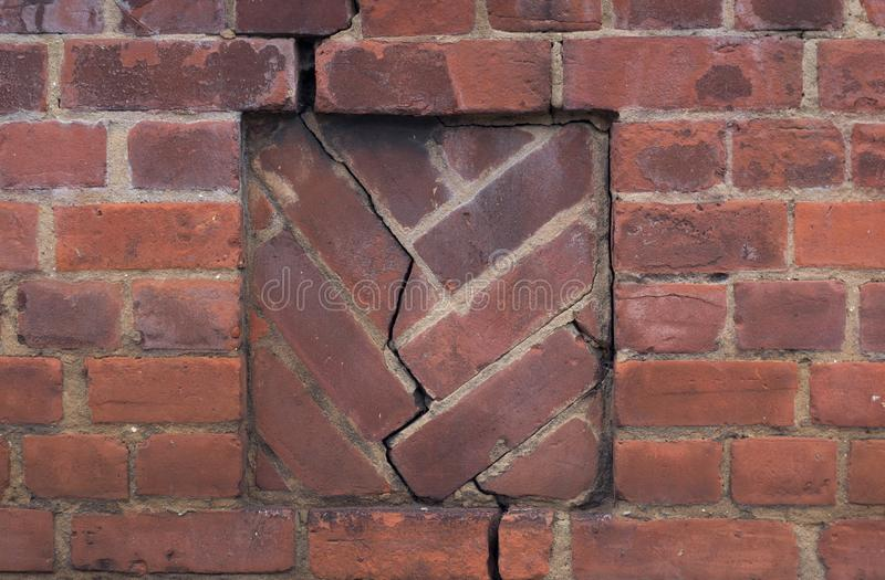 Red Brick Wall with Crack. And damage in the Middle stock images