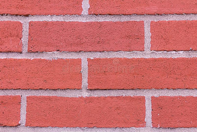 Red brick wall horizontal row rectangle stone cement stripes grunge style closeup background design base urban style stock photography