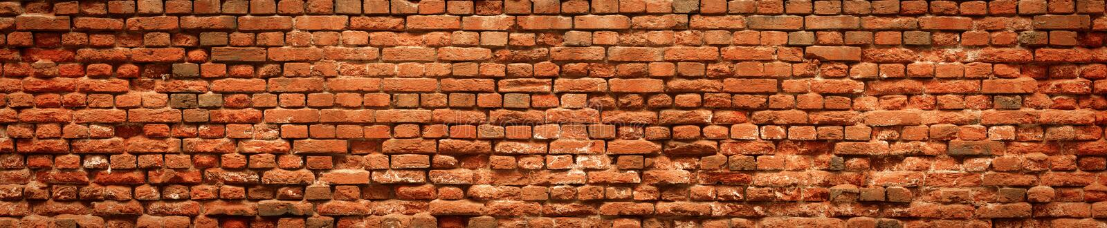 Red Old Brick wall panoramic background in high resolution stock image