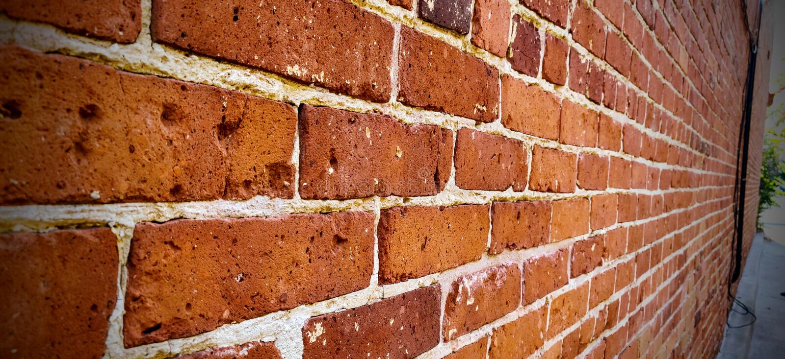 Red Brick wall perspective with vanishing point. Brick wall detail/close-up with perspective and vanishing point. Old bricks with white mortar and great texture royalty free stock images