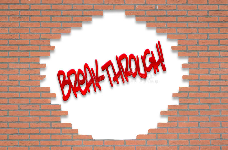 Red brick wall with the text BREAKTHROUGH! royalty free stock photo