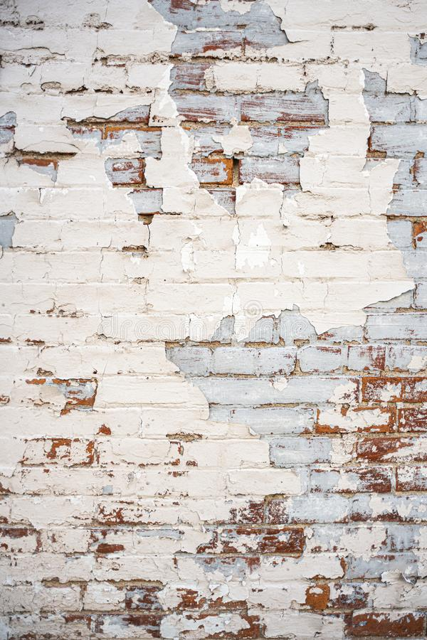 Red brick wall white and blue peeling paint background royalty free stock images