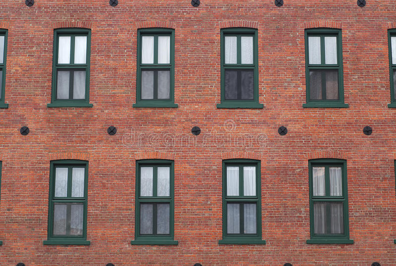 Red brick wall windows residential building facade stock for Windows for residential homes