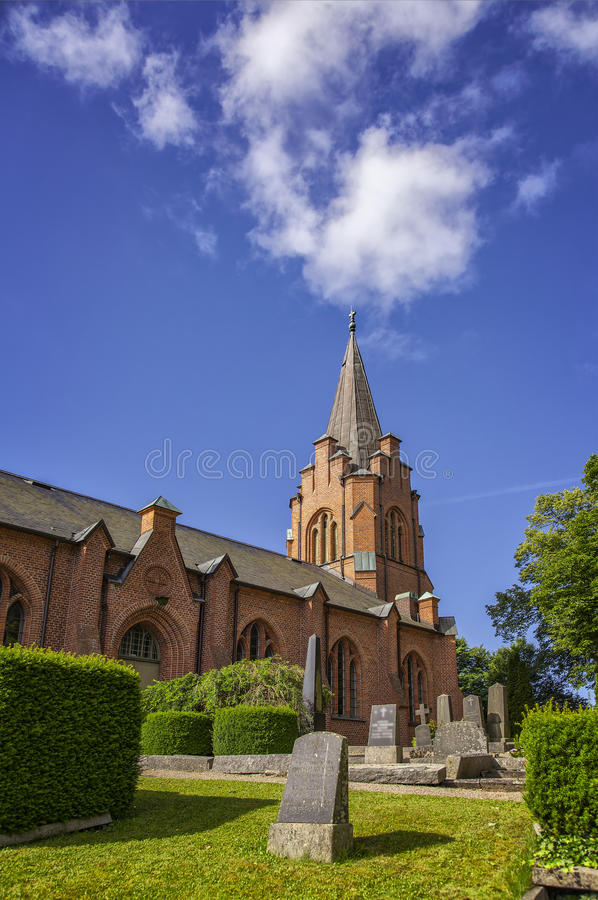 Red bricked church. Image of a typical red brick church in Sweden. Billinge, Skane royalty free stock photo