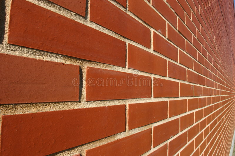 Red bricked wall in perspective. Of a modern building stock image