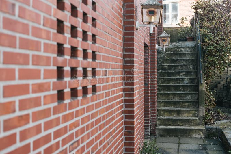 Red bricked wall with village view. And grungy stairs stock photography