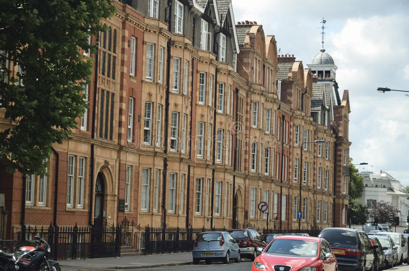 Red bricks houses on street of London, english architecture royalty free stock photos