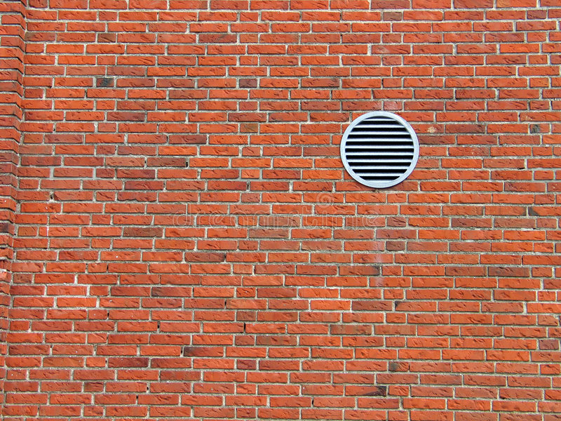 Red bricks wall. With a small ventilation window - architecture abstract royalty free stock photo