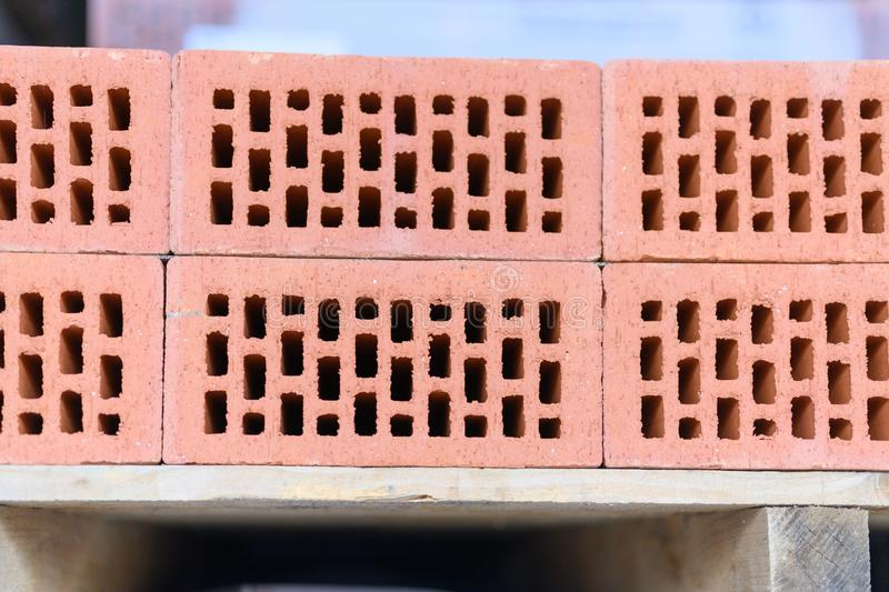 Red bricks on a wooden industrial pallet stock photos