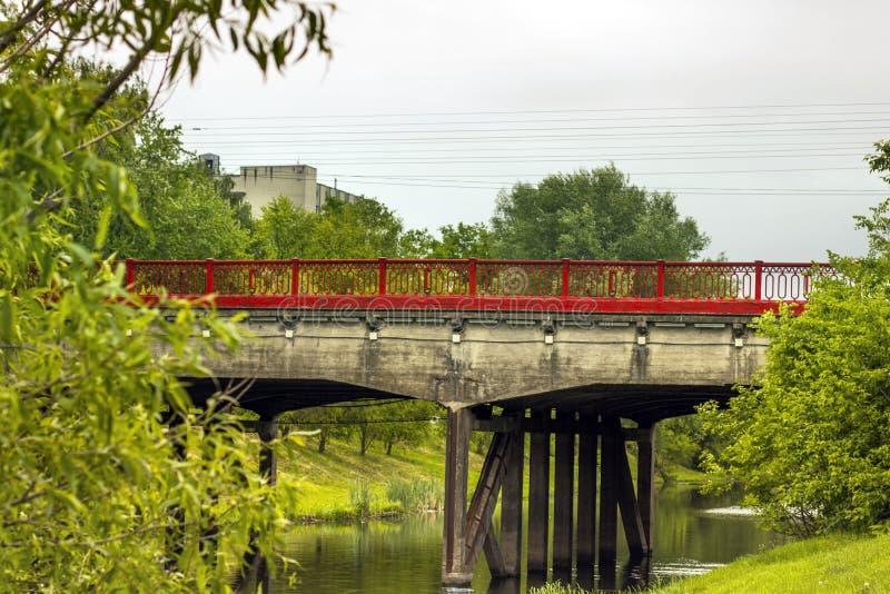 Red bridge in the city. Bridge over the river.  stock photos