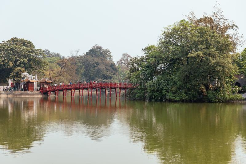 Red Bridge at Hoan Kiem Lake with tress and reflected shadow in Hanoi, Vietnam royalty free stock image