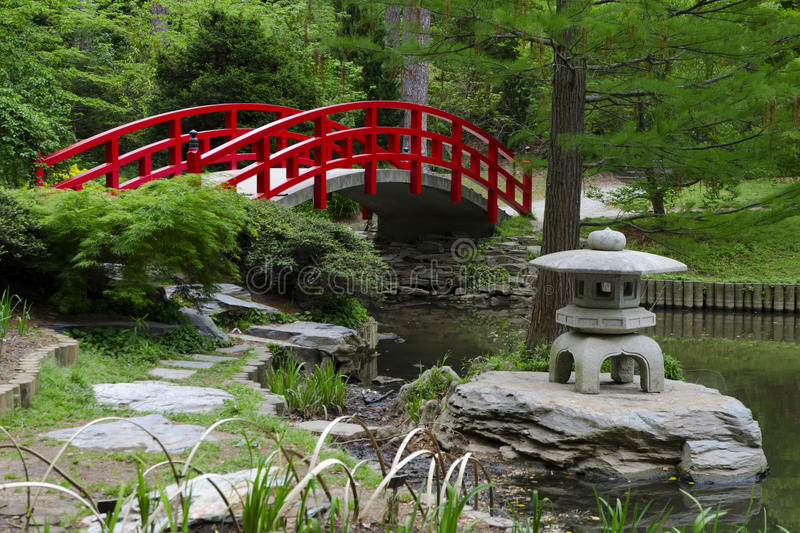 Red Bridge In Japanese Garden Royalty Free Stock Photo