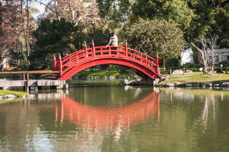Red bridge in lake in city stock photo