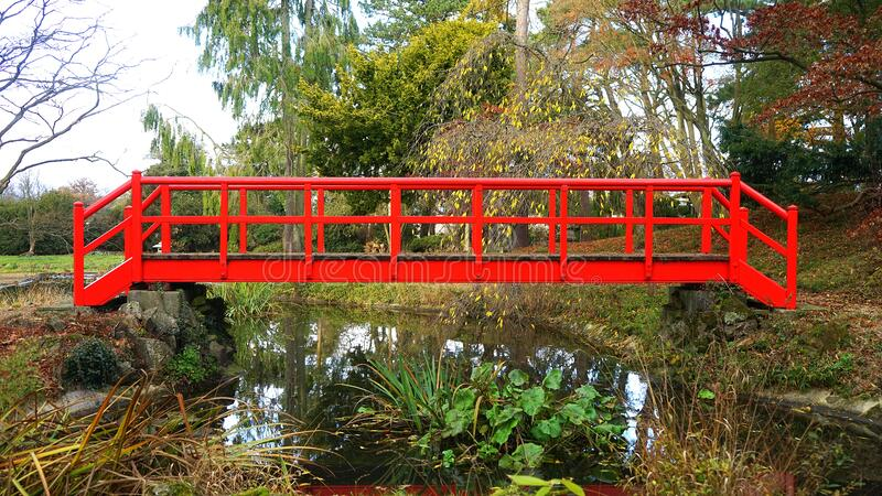 Red bridge over creek royalty free stock photos
