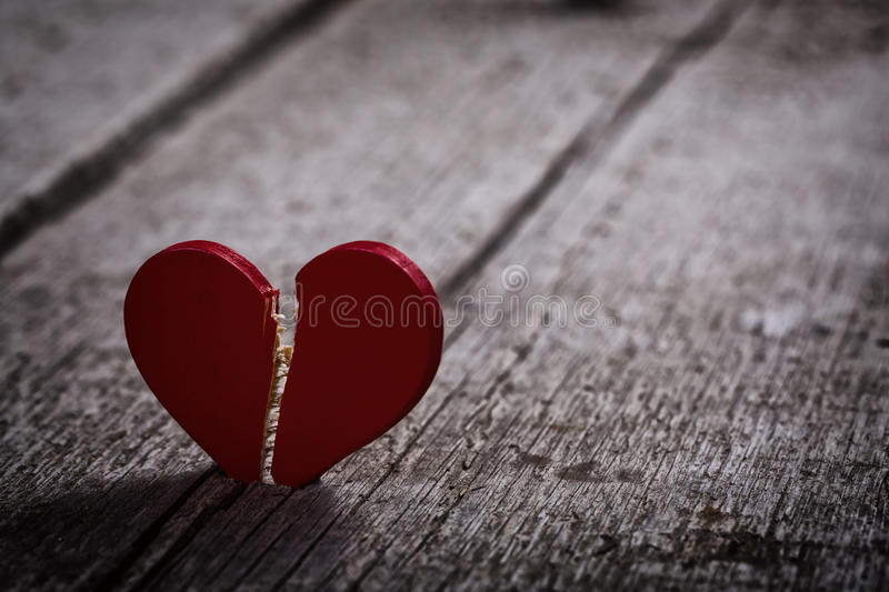 Red broken heart royalty free stock photography