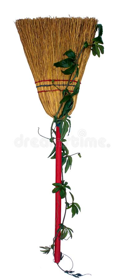 A red broom decorated for Halloween. A witch``s broom decorated for for Halloween and isolated on a white background stock images