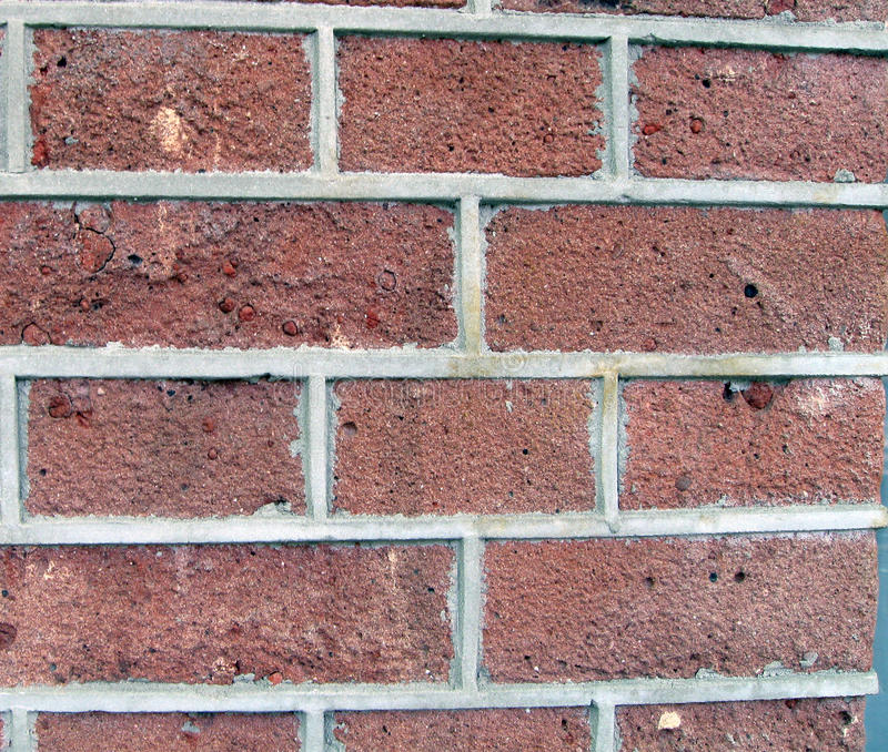 Red brown brick wall, cement, urban building stock photography
