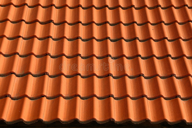 Red brown ceramic roof tiles pattern background stock photo
