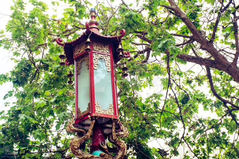 Red and Brown Light Post Under Green Leaf Tree stock photos