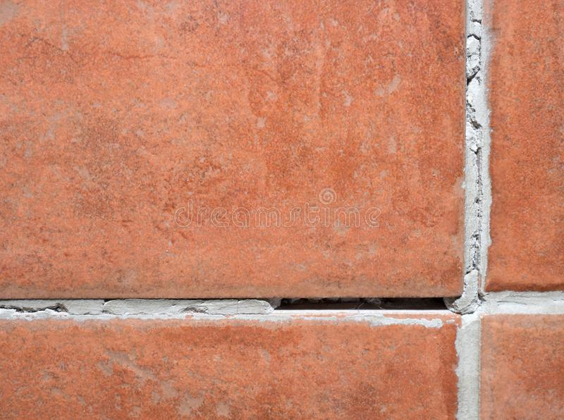 Red brown tiles with grouts. Slippery floor. Red brown tiles with natural grouts. Slippery floor in bathroom or kitchen. Nice example work surface stone square royalty free stock images