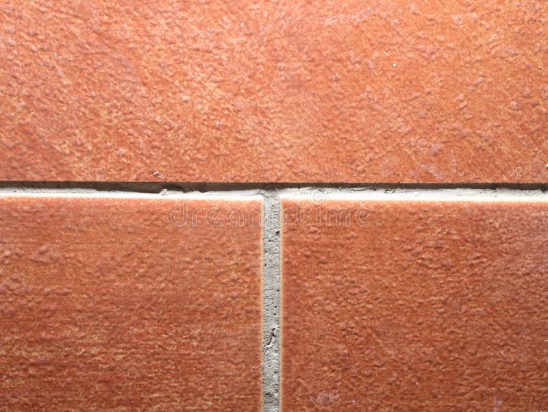 Red brown tiles with grouts. Slippery floor. Red brown tiles with natural grouts. Slippery floor in bathroom or kitchen. Nice example, work, surface, stone stock photo