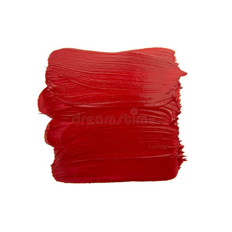 Red brush stroke. Isolated on grunge background royalty free stock photography