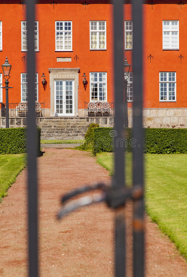 Red building behind gate royalty free stock images