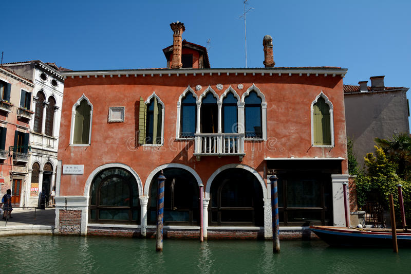 Download Red Building At Canal In Venice, Italy Editorial Photography - Image: 83705807
