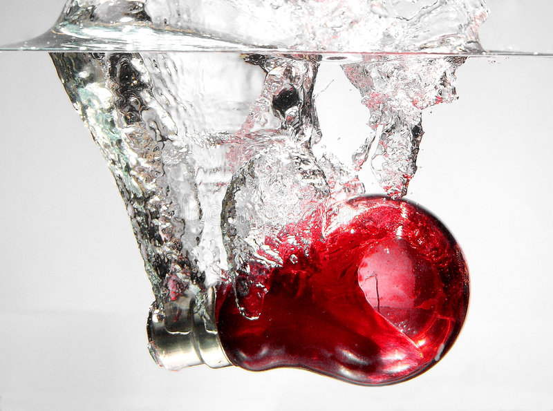Red bulb in water. Red bulb hitting water with a splash royalty free stock photos
