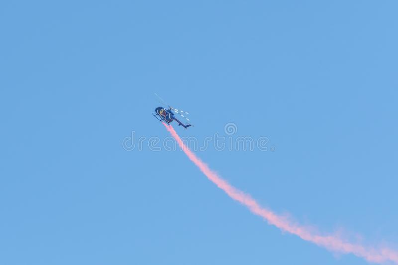 Red Bull aerobatic helicopter  during the Miramar Air Show royalty free stock photo