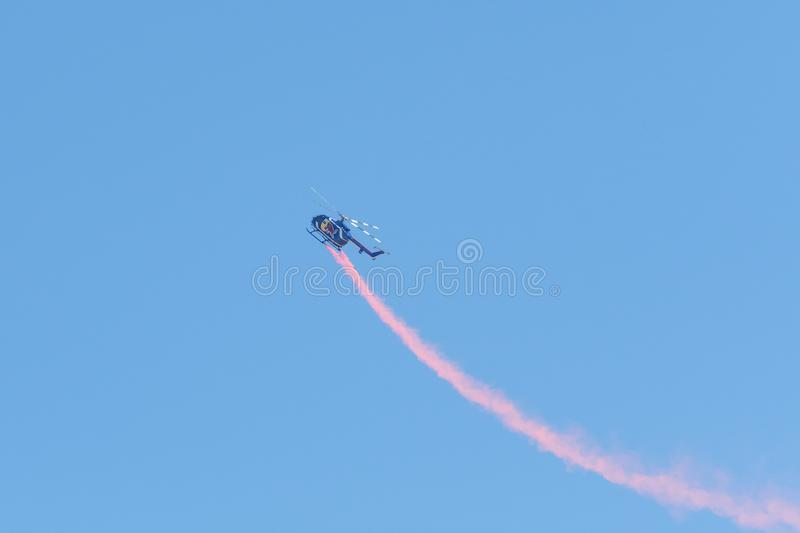 Red Bull aerobatic helicopter  during the Miramar Air Show royalty free stock image