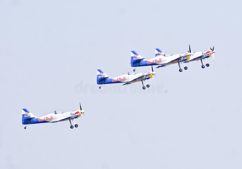 Red Bull display aerobatic team taking off at Aero India Show 2013. royalty free stock photo